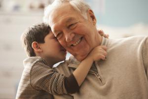 Boy speaking with his grandad