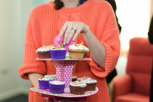 Woman holding a cupcake tower