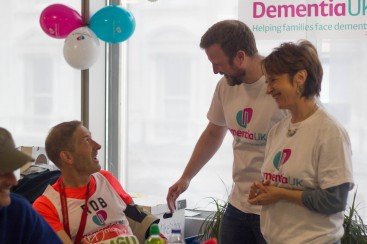 Two volunteers at a Dementia UK fundraising event