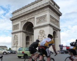 London to Paris Cyclists riding past Arc de Triomphe