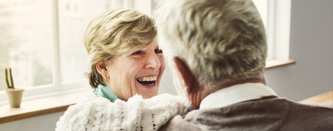 person with dementia and carer lauging