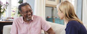 Female Support Worker Visits Senior Man At Home