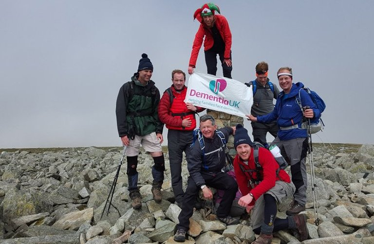 Dementia UK hikers with Dementia UK flag