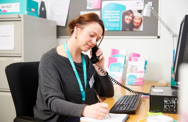 Dementia UK worker on phone