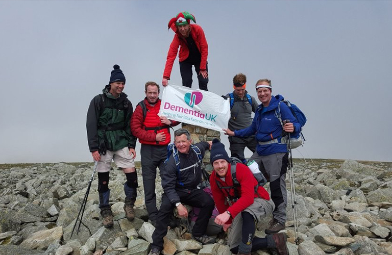 Hikers holding Dementia UK flag