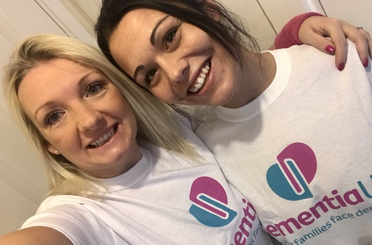 two Dementia UK fundraisers embracing