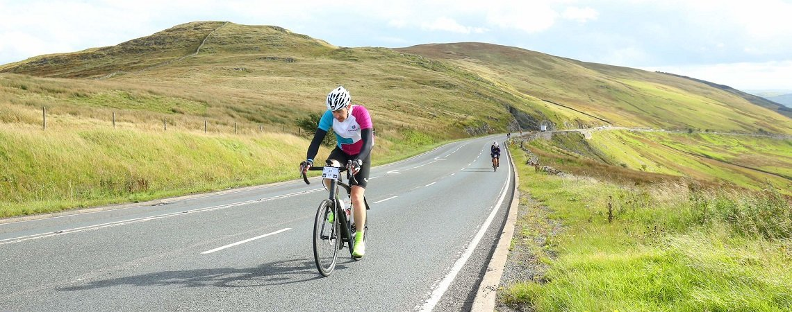 Man on a cycling challenge through countryside