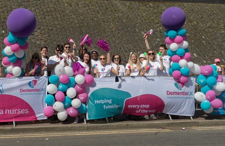 Volunteer at an event with Dementia UK
