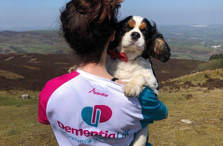 Dementia UK fundraiser holding dog